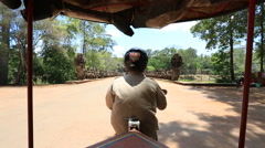 Driving into angkor wat Cambodia Stock Footage
