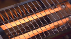 Turning off the electric heater with orange spirals - stock footage