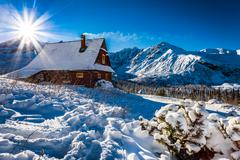 Enjoy your accommodation in winter mountains Stock Photos