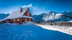 Warm accommodation in a mountain cottage in winter Stock Photos