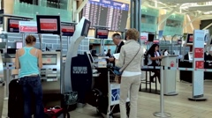 people printing out boarding card at air canada counter - stock footage