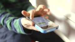 Young boy texting on a smartphone device - stock footage