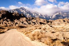 dirt road into alabama hills sierra nevada range california - stock photo