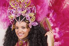 beautiful samba dancer wearing pink costume and smiling - stock photo