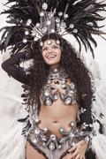 cheerful samba dancer wearing black costume - stock photo