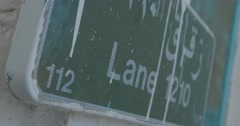 Stock Video Footage of Close up of an Address Sign in Muscat (4K)