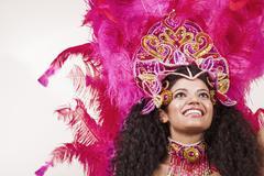 cheerful samba dancer wearing pink costume - stock photo