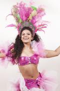 gorgeous samba dancer wearing traditional pink costume - stock photo