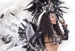 samba dancer posing and smiling - stock photo