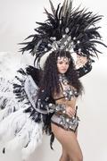 samba dancer wearing traditional black costume and posing - stock photo