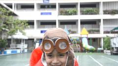 Little boy smiling pretend a pilot dress Stock Footage