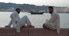 Footage of Two Men Sitting at Mutrah Corniche (4K) Stock Footage