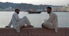 Stock Video Footage of Footage of Two Men Sitting at Mutrah Corniche (4K)