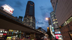 Time lapse footage of the evening sky over Cerulean Tower and Shibuya cityscape Stock Footage