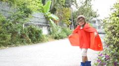 Little boy  pretend as a super herp - stock footage