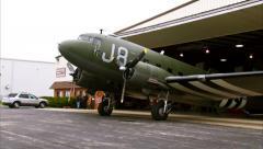 WWII Military Transport C-47 Dakota Tug Out of Hangar Stock Footage