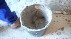 Hands on man taking by trowel mortar for plaster walls Stock Footage