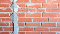 New brick wall with construction mark under plaster Stock Footage