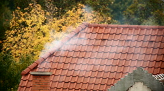 Chimney with smoke rising Stock Footage