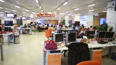 Staff work in office of RIA Novosti russian news agency Stock Footage