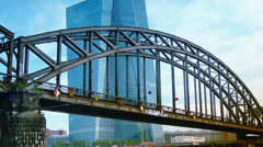 The new European Central Bank Headquarters near a bridge with trains Stock Footage