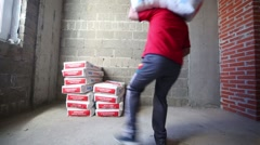 Loader carries bags of dry mortar Knauf in Moscow. Stock Footage