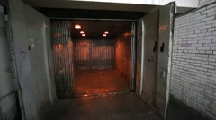 Open cabin of freight elevator in the warehouse room. Stock Footage
