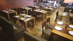 Roomy hall with served tables and walls of bricks in restaurant. Stock Footage