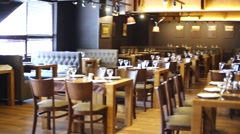 Panoramic overview of the restaurant hall with served tables. Stock Footage