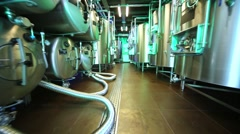 Moving between rows of tanks in microbrewery. Stock Footage