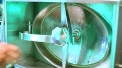 Male hand checks the lid of hatch in horizontal steel tank. Stock Footage
