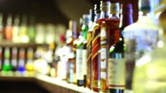 Shelf with many bottles of beverages in the restaurant. Stock Footage