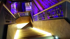 Wooden staircase lit from below in brewery restaurant. Stock Footage