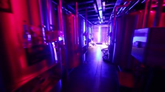 Moving between rows of steel tanks at microbrewery. Stock Footage