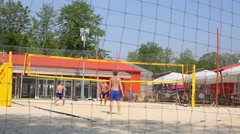 Young guys play volleyball in recreation zone of Gorky Park. Stock Footage
