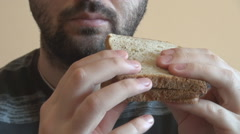 Closeup man mouth eating home made sandwich, morning breakfast, boy chewing Stock Footage