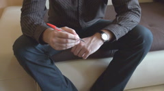 Anxious man view, playing stirred with red color pencil, rotate it endlessly  Stock Footage