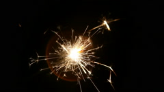 Sparklers burn at night Stock Footage