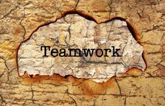 Teamwork text on paper hole Stock Illustration