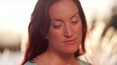 Profile of red haired woman in the park Stock Footage