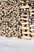 woodshed with pieces of wood piled for winter - stock photo
