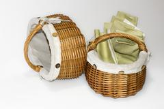 Two wicker baskets with linen cloth Stock Photos