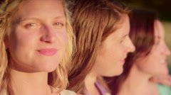 Three young women spending time together in the park - stock footage