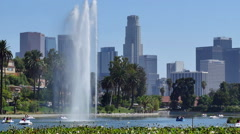 Zoom Out of Water Fountain in Echo Park with Los Angeles in the Background Stock Footage