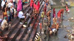 Video 1920x1080 - Indian people at ritual washing in the sacred Ganges river - stock footage
