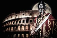 Roman legionary soldier in front of coliseum at night time Stock Photos