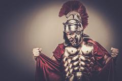Angry legionary soldier in armour Stock Photos