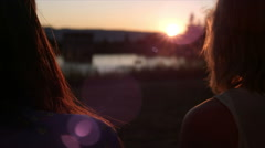 Close up of women in the park at sunset. Lens flare. - stock footage