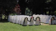 Rows of chairs on lawn ready for outdoor wedding ceremony Stock Footage
