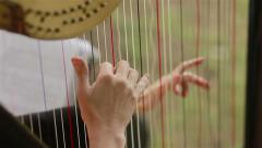 Hands of harpist playing harp. Close-up Stock Footage
